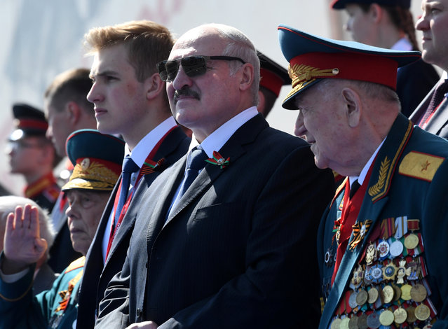 Belarusian President Alexander Lukashenko and his son Nikolai attend the Victory Day Parade in Red Square in Moscow, Russia, June 24, 2020. (Photo by Alexei Nikolskyi/Sputnik/Pool via Reuters)
