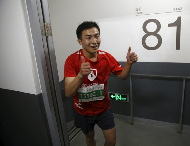 A participant reacts as he runs on stairs during a vertical run event at China World Summit Wing hotel in Beijing, China, September 19, 2015. (Photo by Kim Kyung-Hoon/Reuters)