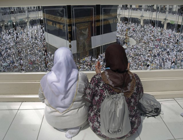 Muslim pilgrims pray around the holy Kaaba at the Grand Mosque ahead of the annual haj pilgrimage in Mecca September 21, 2015. (Photo by Ahmad Masood/Reuters)