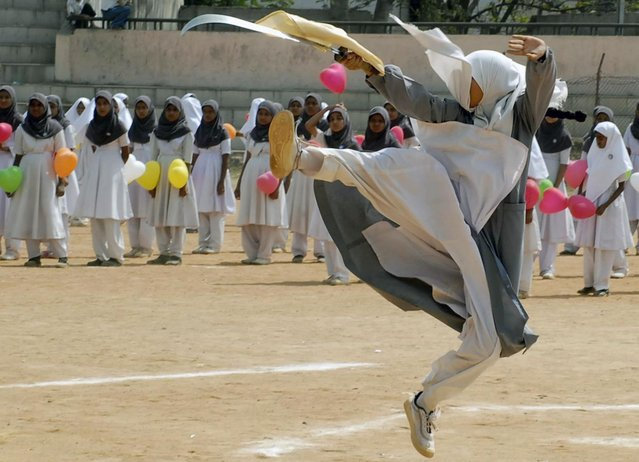 A Muslim schoolgirl performs martial arts during a sports day exhibition in Hyderabad February 7, 2007. (Photo by Krishnendu Halder/Reuters)