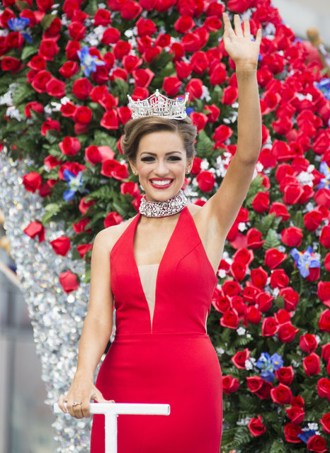 "Miss America 2016 Betty Cantrell waves to the crowd during the 2017 Miss America pageant ""Show Us Your Shoes"" parade Saturday, September 10, 2016, in Atlantic City. (Photo by Chris Szagola/AP Photo)"