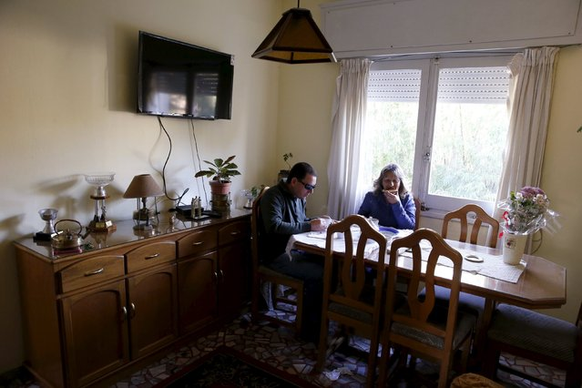 Laura Paipo, first blind principal in Uruguay and her husband Jorge Albarracin eat breakfast at their home in Montevideo, September 18, 2015. (Photo by Andres Stapff/Reuters)