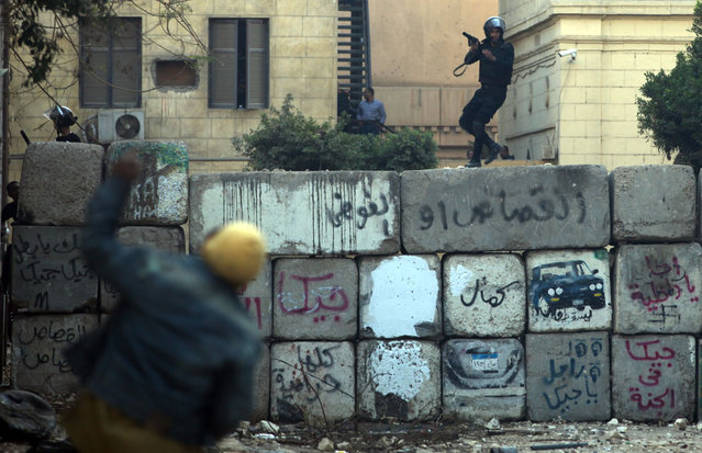Egyptian protesters clash with riot police near Tahrir Square, Cairo, on January 26, 2013. (Photo by Khalil Hamra/AP Photo/The Atlantic)