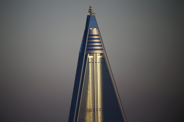 The top of the 105-storey Ryugyong Hotel in Pyongyang, North Korea on October 9, 2015. (Photo by Damir Sagolj/Reuters)
