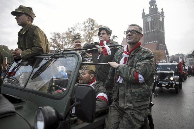 People parade wearing military uniforms during the Independence Day celebrations in Gdansk November 11, 2014. (Photo by Lukasz Glowala/Reuters/Agencja Gazeta)