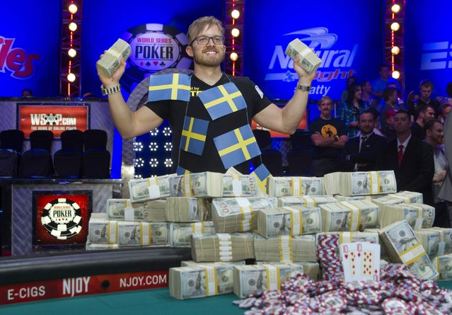 Martin Jacobson, 27, of Sweden poses with cash after beating Felix Stephensen of Norway to win the $10 million first prize during the 2014 World Series of Poker main event at the Rio hotel-casino in Las Vegas, Nevada, November 11, 2014. (Photo by Steve Marcus/Reuters/Las Vegas Sun)