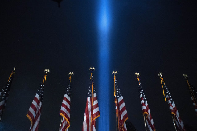 A beam of light is seen over the Pentagon, as part of the Towers of Light Tribute marking the 19th anniversary of the 9/11 attack on the Pentagon, Wednesday, September 9, 2020, in Washington. (Photo by Jose Luis Magana/AP Photo)