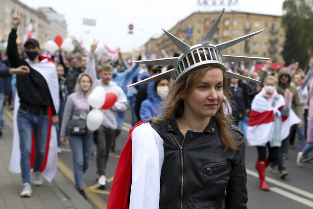 A woman wearing a crown similar to the one on the American statue of Liberty, during an opposition rally to protest the official presidential election results in Minsk, Belarus, Sunday, September 27, 2020. (Photo by TUT.by via AP Photo)