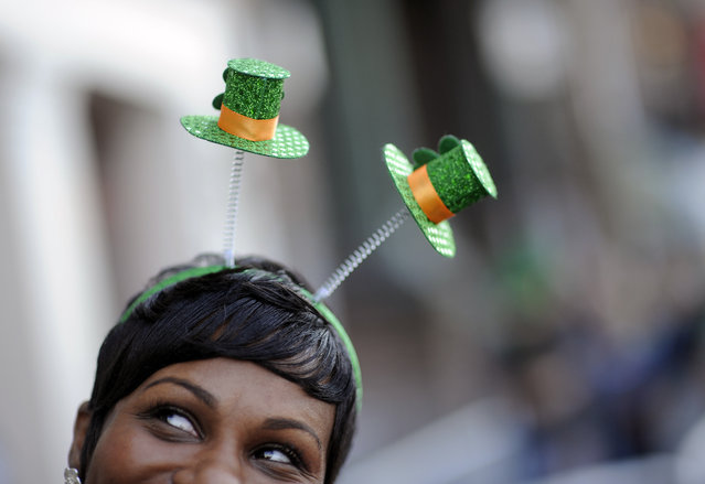 Krystal Thomas of Atlanta parties on River Street while wearing a shamrock head-band during the 189th St. Patrick's Day celebration, Friday March 16, 2013 in Savannah, Ga. (Photo by Stephen Morton/AP Photo)