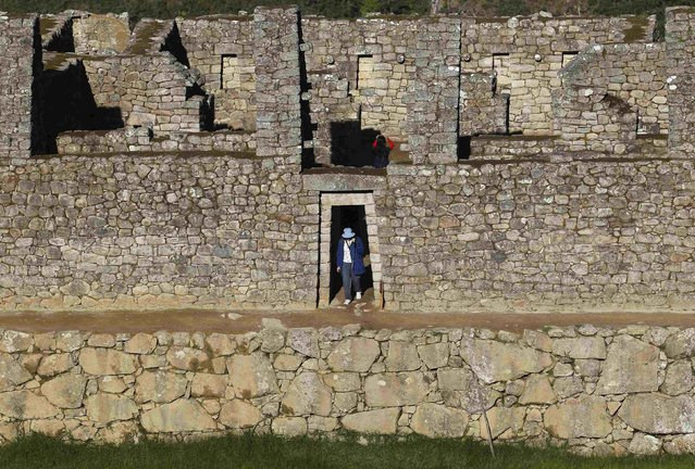 A visitor walks at the Inca citadel of Machu Picchu in Cusco December 2, 2014. (Photo by Enrique Castro-Mendivil/Reuters)