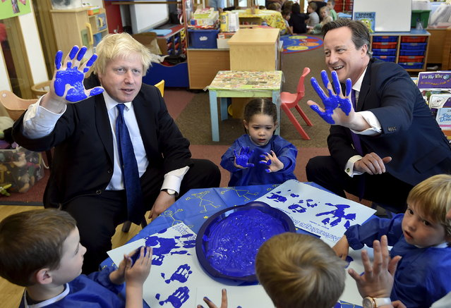 Britain's Prime Minister David Cameron (R) and London Mayor Boris Johnson (L) react as they join a hand-printing session with children at the Advantage children's daycare nursery in Surbiton in south west London, April 22, 2015. (Photo by Toby Melville/Reuters)