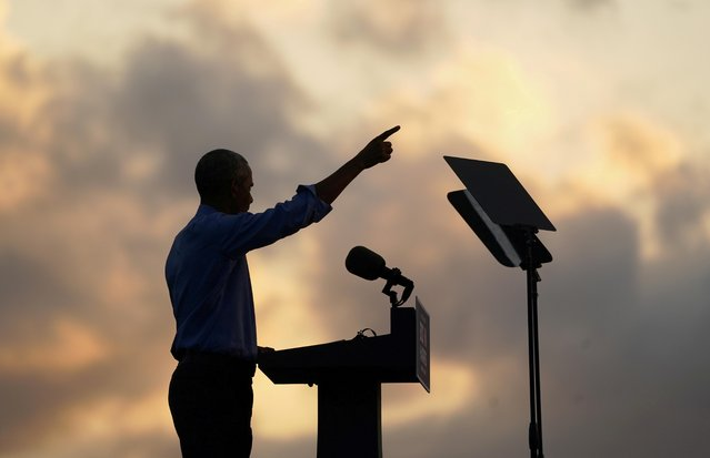 Former U.S. President Barack Obama campaigns on behalf of Democratic presidential nominee and his former Vice President Joe Biden in Philadelphia, Pennsylvania, U.S., October 21, 2020. (Photo by Kevin Lamarque/Reuters)