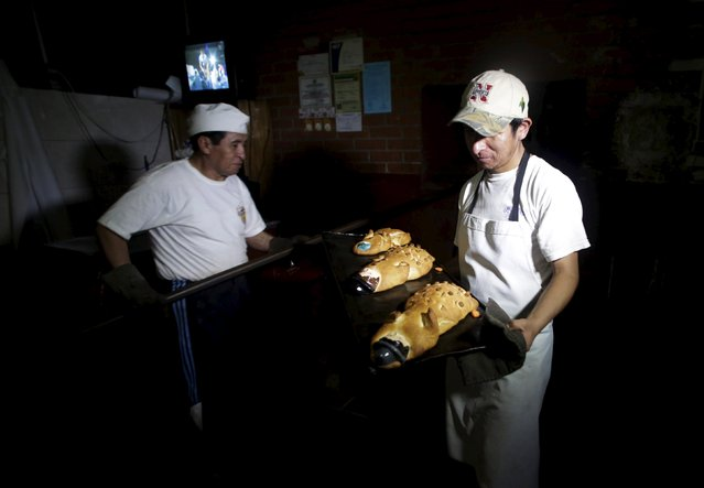 """Bakers work to make """"Tantawawas"""" (Children's bread) in a backhouse in La Paz, October 28, 2015. (Photo by David Mercado/Reuters)"""