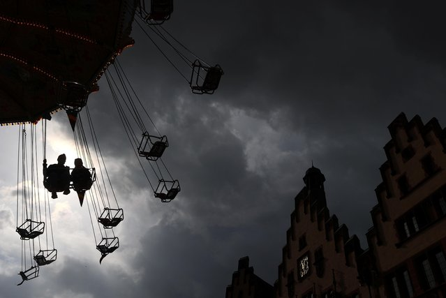 People ride a carousel as the spread of the coronavirus disease (COVID-19) continues, in Frankfurt, Germany, October 12, 2020. (Photo by Kai Pfaffenbach/Reuters)