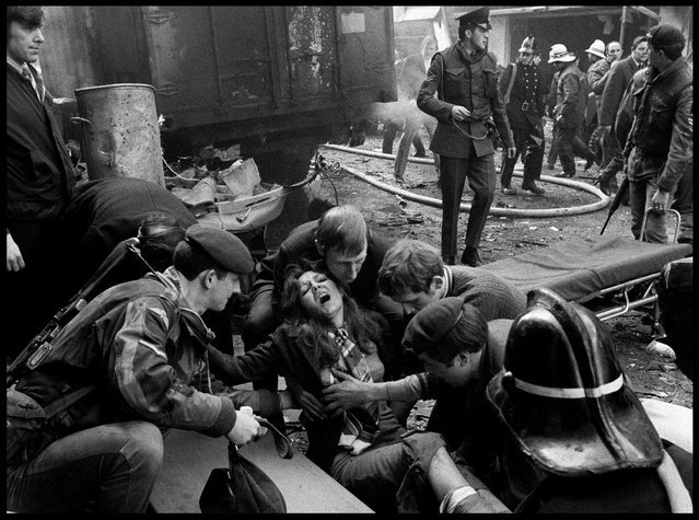 Belfast, Northern Ireland, 1972. A woman wounded in an IRA bomb explosion in the city centre is given first aid. (Photo by Abbas Attar/Magnum Photos)