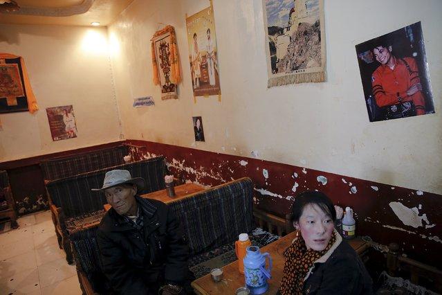 Pilgrims have hot yak butter tea after visiting the Jokhang Temple in central Lhasa, Tibet Autonomous Region, China November 20, 2015. (Photo by Damir Sagolj/Reuters)