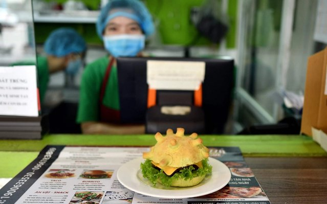 A coronavirus-themed burger is pictured at the Pizza Home restaurant in Hanoi on March 26, 2020, amid restrictions being put in place to contain the spread of the COVID-19 coronavirus. (Photo by Manan Vatsyayana/AFP Photo)