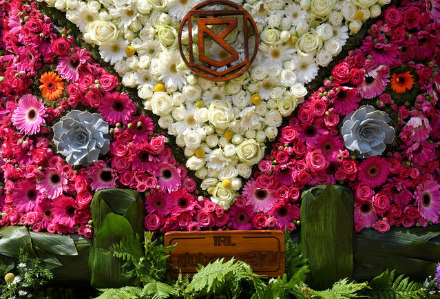"""Detail of a floral display and design based on a VW campervan is seen outside of a shop front which is participating in the Chelsea In Bloom festival in London, Britain on May 22, 2018. The annual show of floral art, timed to coincide with the RHS Chelsea Flower Show nearby, sees over sixty shops, restaurants and local businesses compete for prizes, with the awards given by RHS (Royal Horticultural Society) judges, this year on the theme of """"Summer of Love"""". (Photo by Toby Melville/Reuters)"""
