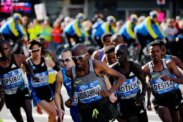 The men's leading pack run during the 2016 New York City Marathon in the Brooklyn borough of New York City, U.S., November 6, 2016. (Photo by Eduardo Munoz/Reuters)