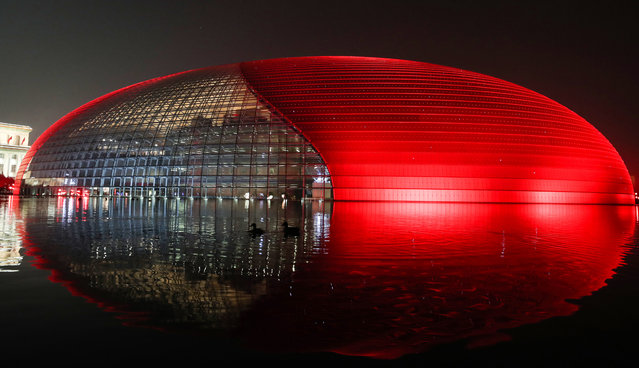 The National Center for the Performing Arts is illuminated to mark the upcoming Chinese New Year, the Year of the Ox, on February 10, 2021 in Beijing, China. (Photo by Jiang Qiming/China News Service via Getty Images)