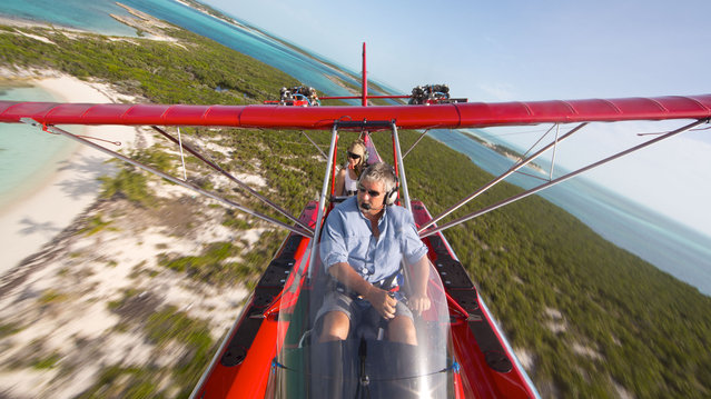 """Flying the Exuma Islands in a canoe with wings"". Flying over the Exuma Islands of the Bahamas in a twin engine canoe with wings, a mounted camera with a remote trigger allowed this photographer to capture the moment forever. Location: Exuma Islands, Bahamas. (Photo and caption by Leona Boyd/National Geographic Traveler Photo Contest)"