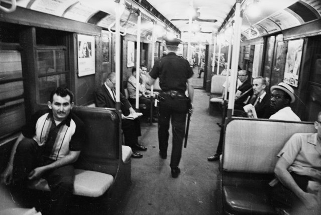 An American policeman on patrol in the New York subway, August 11, 1965. (Photo by Harry Benson/Express/Getty Images)