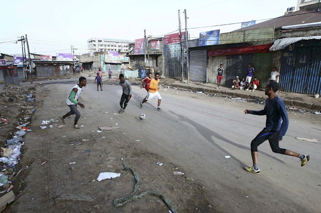 Boys play soccer in the streets of the Mercato market in Addis Ababa June 14, 2015. (Photo by Tiksa Negeri/Reuters)