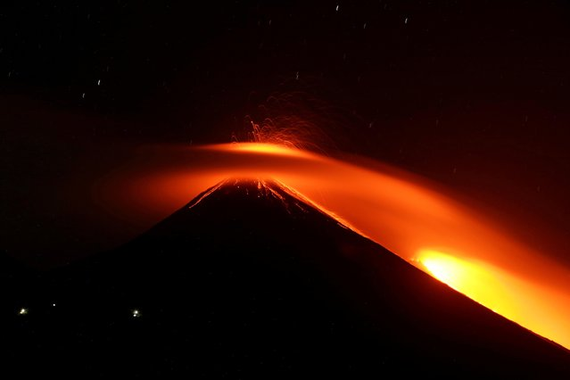 Streams of red hot lava shoot into the night sky during an eruption of the Pacaya volcano, as seen from Los Rios, Guatemala on March 3, 2021. (Photo by Josue Decavele/Reuters)