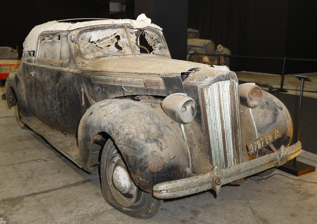 A Packard Eight Cabriolet displayed during a preview for an auction of vintage cars Retromobile show in Paris, Tuesday, February 3, 2015, after a treasure trove of classic cars was discovered after spending 50-years languishing in storage on a farm. (Photo by Jacques Brinon/AP Photo)