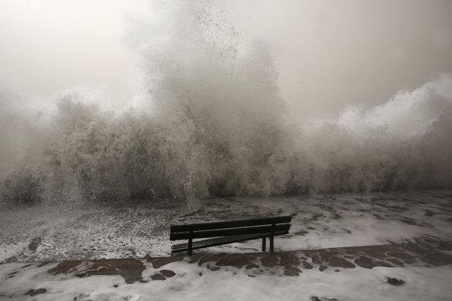 Huge waves hit a promenade at Floisvos suburb, west of Athens, Sunday, February 1, 2015. (Photo by Yorgos Karahalis/AP Photo)