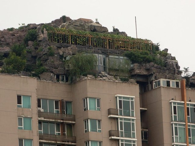 Rock Villa on Top of Apartment Tower in China