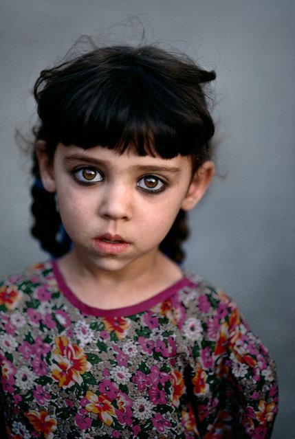 Girl in Kandahar orphanage, Afghanistan. (Photo by Steve McCurry)