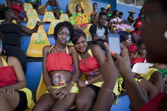 Dancers pose for a photo at the national stadium as they wait for the start of Carnival celebrations in Port-au-Prince, Haiti, Monday, February 16, 2015. (Photo by Dieu Nalio Chery/AP Photo)