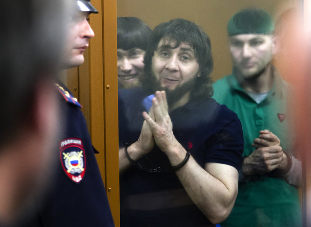 In this file photo taken on Thursday, July 13, 2017, Zaur Dadayev, center left, Anzor Gubashev, center, and Shadid Gubashev, center right, listen to the sentence in a court room in Moscow, Russia. Zaur Dadayev, convicted in the 2015 assassination of leading opposition figure Boris Nemtsov. A hunger strike by jailed Russian opposition leader Alexei Navalny cast a spotlight on the country's prison system that critics say is built on fear and torment. Navalny was transferred Sunday, April 18, 2021 from his prison colony to a hospital in another prison amid reports about his declining health that drew international outrage. Nearly 520,000 inmates occupy Russia's prison system - numerically by far the largest prison population in Europe. Most of the prisons are collective colonies, a system dating back to the Soviet Gulag era, with workshops and inmates sleeping in dormitories. (Photo by Ivan Sekretarev/AP Photo/File)