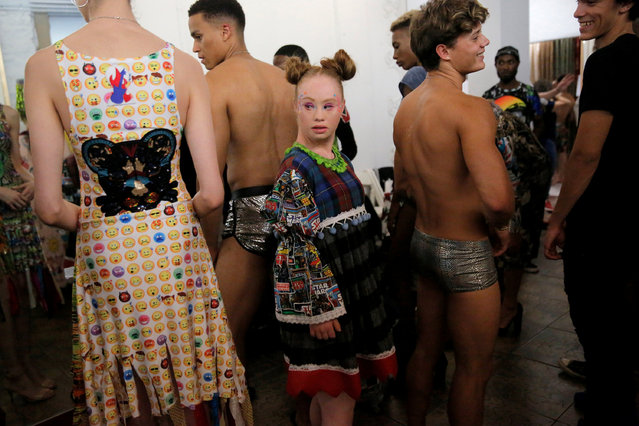 Model Madeline Stuart stands backstage before walking in the Burning Guitars runway show during New York Fashion Week, New York, U.S., September 6, 2018. (Photo by Andrew Kelly/Reuters)