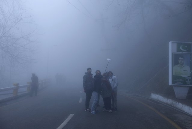 Tourists take selfie pictures amidst heavy fog on a cold winter day in the hill-resort town of Murree, northeast of capital Islamabad, Pakistan, January 12, 2016. (Photo by Faisal Mahmood/Reuters)