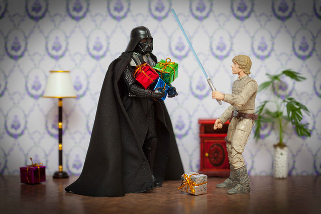 Darth Vader gives presents to Luke Skywalker, taken in Glasgow, Scotland, December 2016. Tiny Storm Troopers and a mini Darth Vader are captured doing everyday activities – from taking a bath, to wrapping presents. Scottish Artist and Photographer, David Giliver created these scenes over a period of two years using toys and miniature props. (Photo by David Gilliver/Barcroft Images)