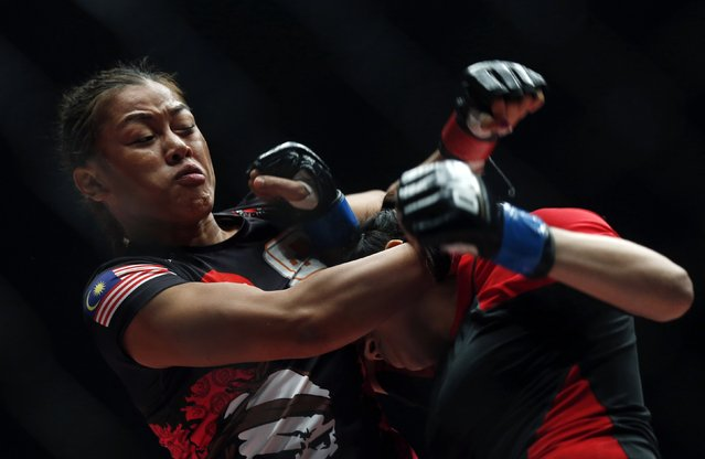 Malaysia's Ann Osman (L) throws punches during her mixed martial arts (MMA) ONE Championship fight against Egypt's Walaa Abbas in Kuala Lumpur, March 13, 2015. (Photo by Olivia Harris/Reuters)