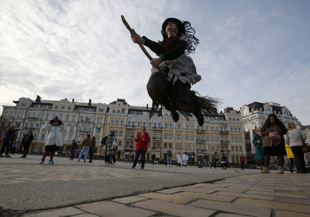 Reveller in costume with a broom jumps during a Zombie Walk event in central Kiev, Ukraine on October 27, 2018, ahead of Halloween celebrations on October 31. (Photo by Anatolii Stepanov/AFP Photo)