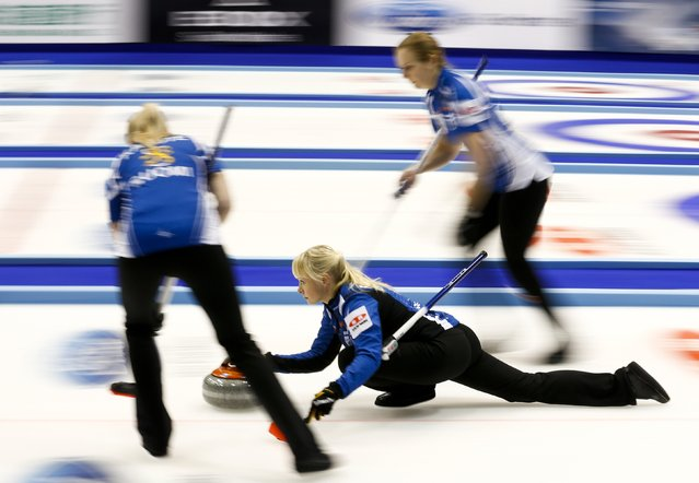 Finland's skip Saana Puustinen (C) delivers a stone as her team mates Marjo Hippi (R) and Oona Kauste prepare to sweep during their curling round robin game against Germany during the World Women's Curling Championships in Sapporo March 16, 2015. (Photo by Thomas Peter/Reuters)
