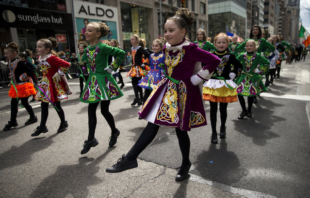 Children from the Irish Dancing and Music Association of North America perform as they march in the 254th New York City St. Patrick's Day parade up 5th Avenue in Manhattan Borough of New York, March 17, 2015. (Photo by Mike Segar/Reuters)