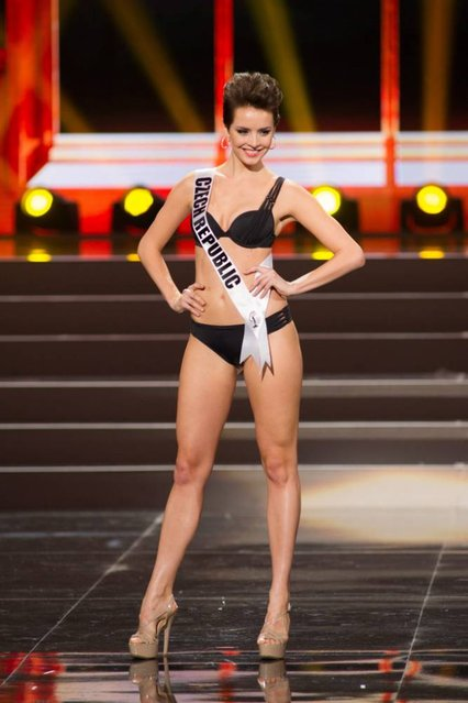 A handout picture provided by the Miss Universe Organization shows Gabriela Kratochvílová, Miss Czech Republic 2013, competing in the swimsuit competition during the Preliminary Competition at the Crocus City Hall, in Moscow, Russia, 05 November 2013. (Photo by Darren Decker/EPA)
