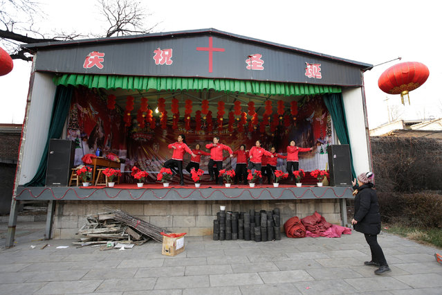 Villagers dance during a rehearsal befor performing on the Christmas Eve, outside of a Catholic church on the outskirts of Taiyuan, North China's Shanxi province, December 23, 2016. (Photo by Jason Lee/Reuters)