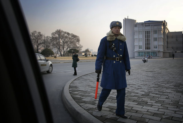A North Korean traffic police officer mans a street junction on Monday, November 30, 2015, in Pyongyang, North Korea, as residents commute at the end of their work day. (Photo by Wong Maye-E/AP Photo)