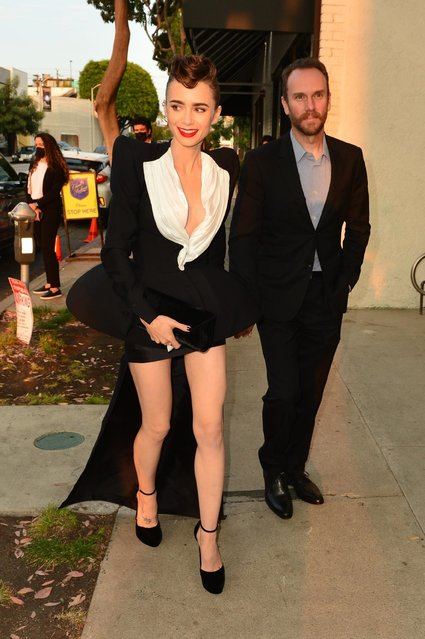 British-American actress Lily Collins and her partner Charlie McDowell steal the show as they arrive at Cartier's Clash Unlimited launch party in West Hollywood, CA. on August 25, 2021. (Photo by Backgrid USA)
