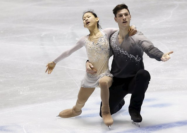 Ami Koga and Francis Boudreau Audet of Japan compete during the pairs free skating program at the ISU World Team Trophy in Figure Skating in Tokyo April 18, 2015. (Photo by Yuya Shino/Reuters)