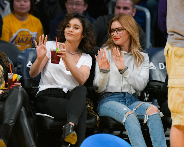 Vanessa Hudgens (L) and Ashley Tisdale attend a basketball game between the Detroit Pistons and the Los Angeles Lakers at Staples Center on January 15, 2017 in Los Angeles, California. (Photo by Noel Vasquez/Getty Images)