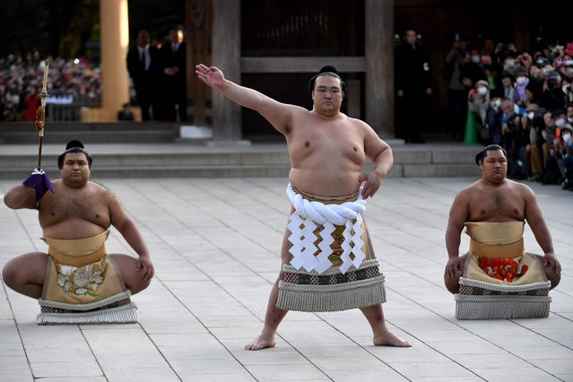 """Newly promoted """"Yokozuna"""" or sumo' s grand champion, Kisenosato (C) performs a ring- entering ceremony beside Tachimochi, or sword carrier, Takayasu (L) and Tsuyuharai, or dew sweeper, Shohozan (R) at Meiji shrine in Tokyo on January 27, 2017 .Japan' s excruciating wait for a homegrown yokozuna ended when 30- year- old Kisenosato was promoted to the ancient sport' s highest rank, the first Japan- born yokozuna in 19 years. (Photo by Toshifumi Kitamura/AFP Photo)"""