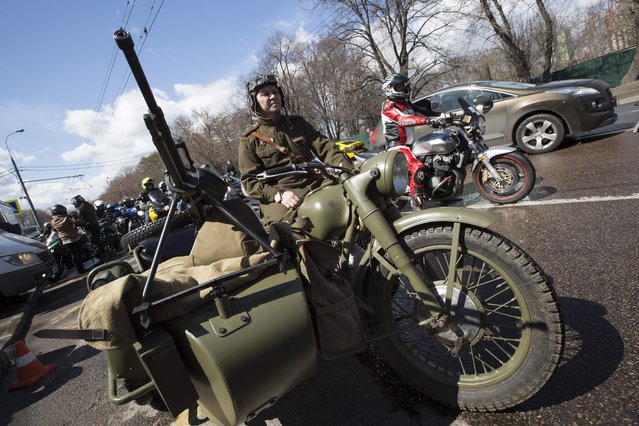 A man wearing a Soviet-era soldier uniform sits in a WWII Soviet army motorcycle as he takes part in seeing off Russian bikers leaving for Germany to mark the 70th anniversary of Soviet victory over Nazi Germany, in Moscow, Saturday, April 25, 2015. (Photo by Alexander Zemlianichenko/AP Photo)