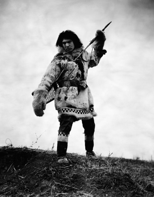 "Eskimo with spear. Still from early documentary ""Igloo"" directed by Ewing Scott, 1932. (Photo by Bettmann Collection)"